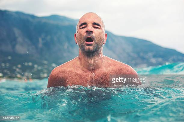 Portrait of a man swimming