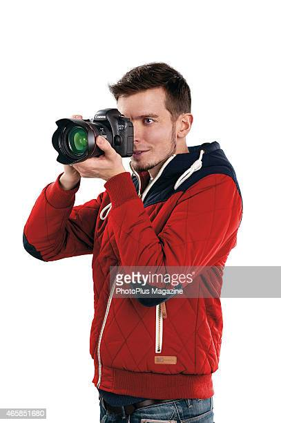 Portrait of a man taking pictures with a Canon EOS 6D DSLR taken on January 27 2014