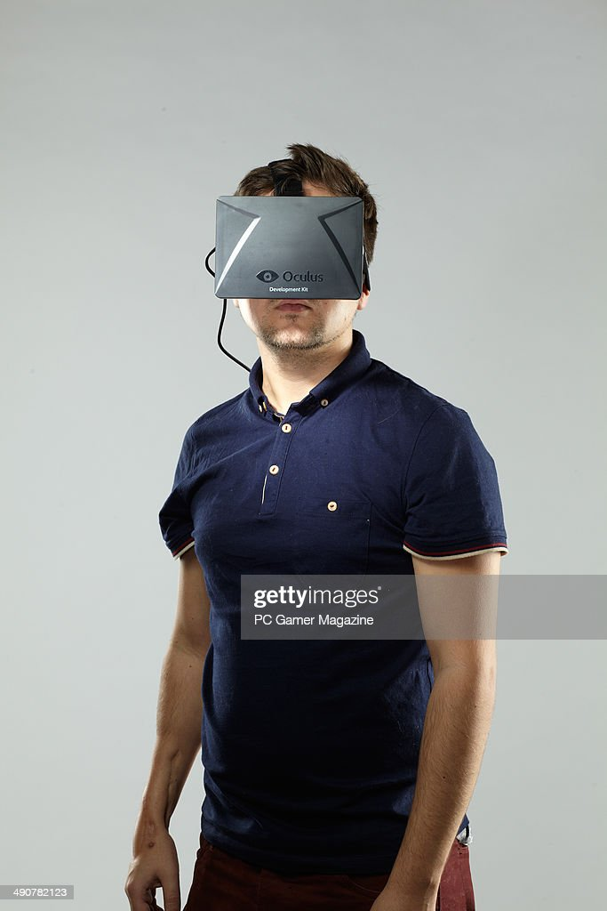 Portrait of a man wearing a development stage Oculus Rift virtual reality head-mounted display, taken on October 3, 2013.