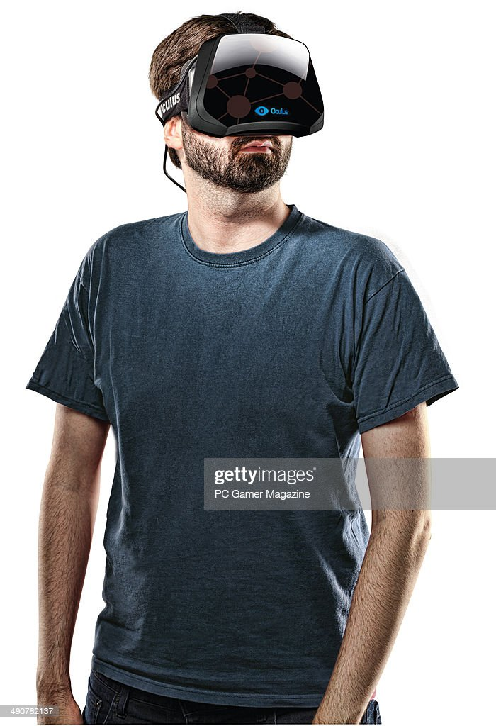 Portrait of a man wearing an Oculus Rift virtual reality head-mounted display, taken on October 3, 2013.