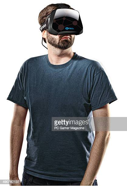Portrait of a man wearing an Oculus Rift virtual reality headmounted display taken on October 3 2013