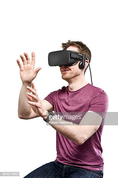 Portrait of a man wearing an Oculus Rift virtual reality headset taken on April 13 2016