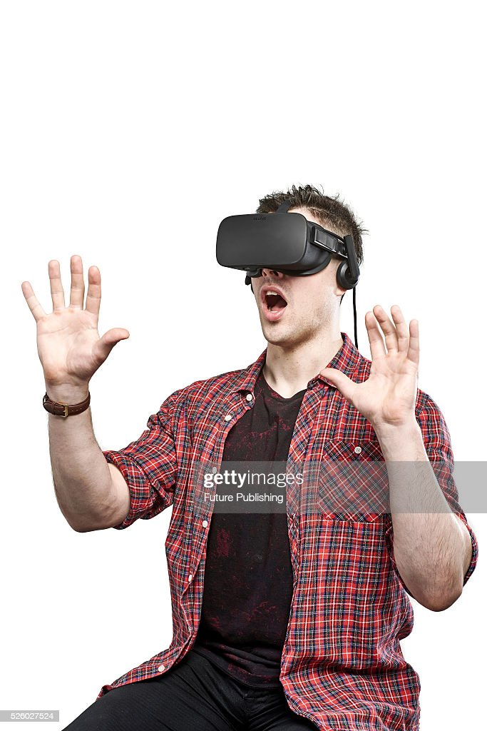 Portrait of a man wearing an Oculus Rift virtual reality headset with a shocked expression, taken on April 13, 2016.