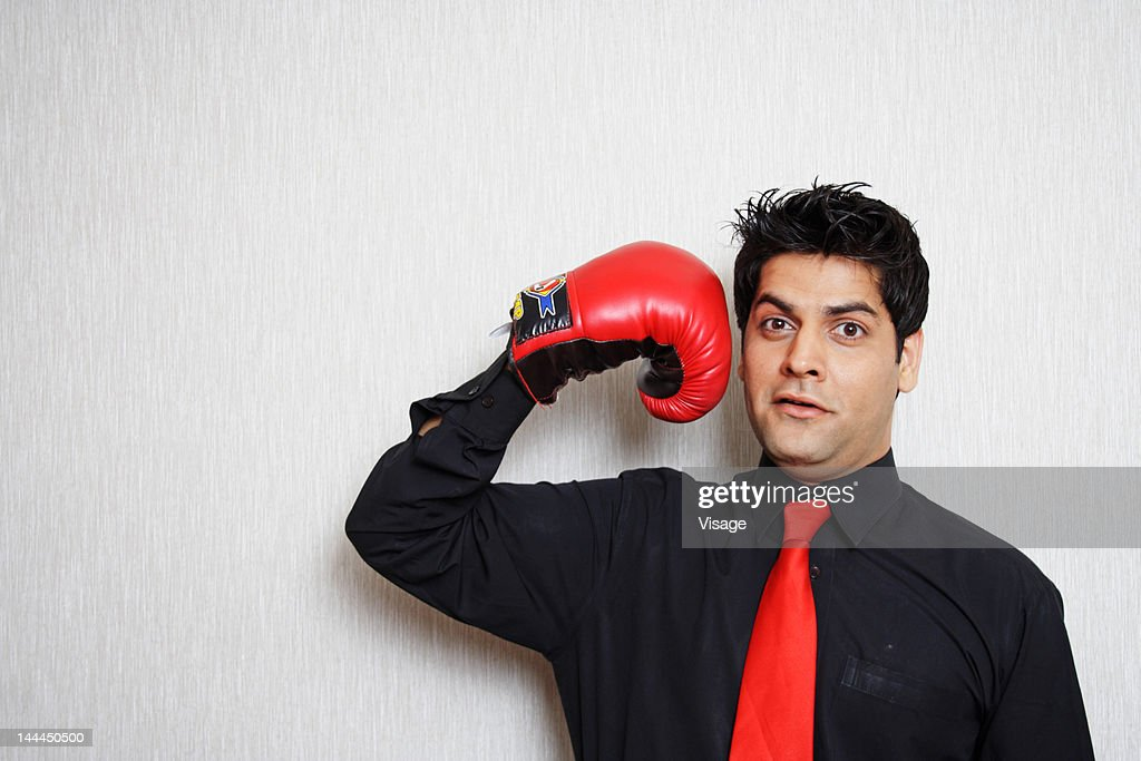 Portrait of a man wearing boxing gloves : Stock Photo
