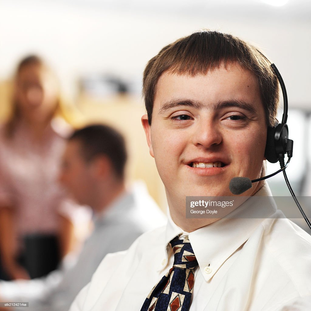 portrait of a man with down syndrome working in a call center