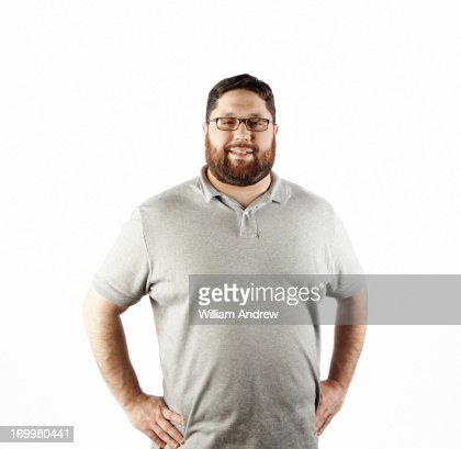 Portrait of a man with hands on hips