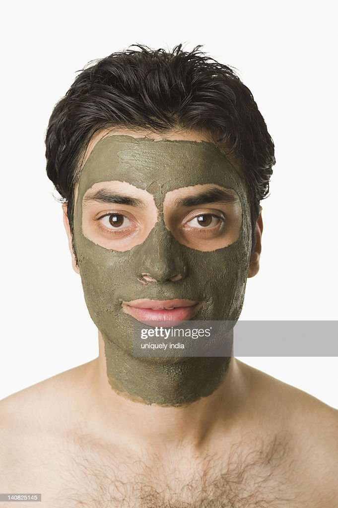 Portrait of a man with mud pack : Stock Photo