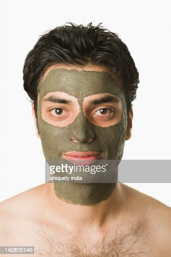 Portrait of a man with mud pack : Stockfoto