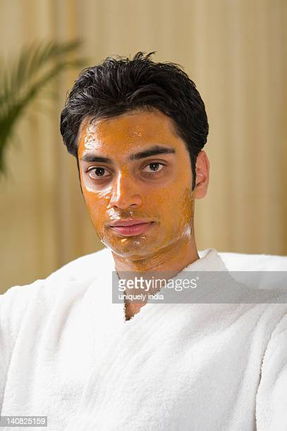 Portrait of a man with peel off mask