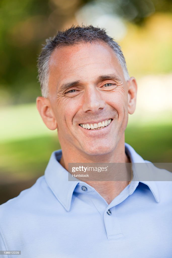 Portrait of a man with spinal cord injury smiling : Stock Photo