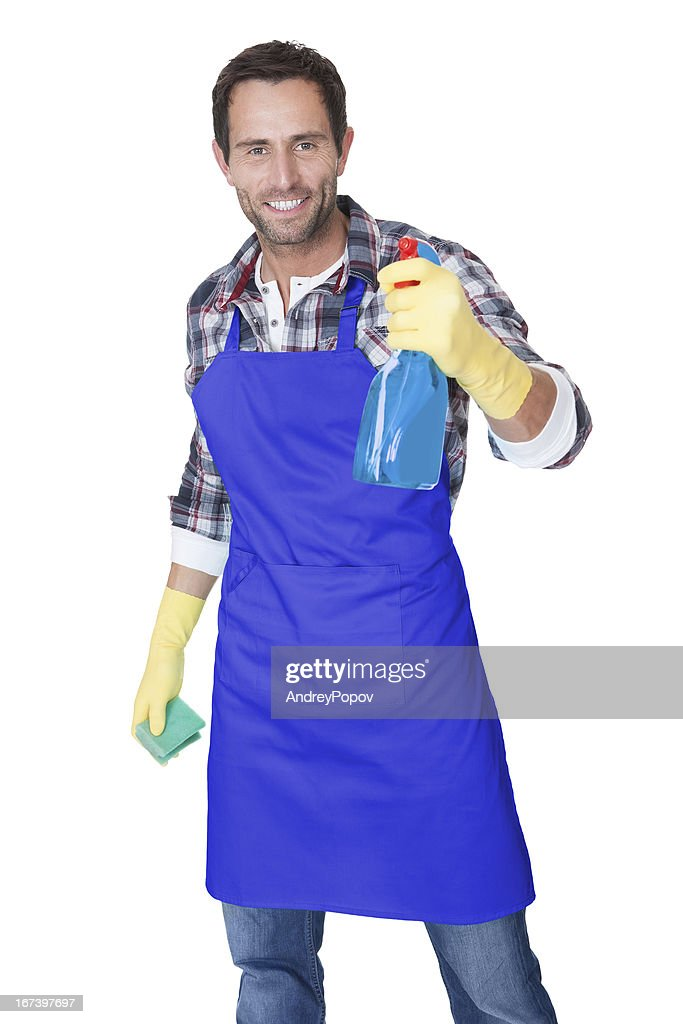Portrait of a man with sponge and spray : Bildbanksbilder