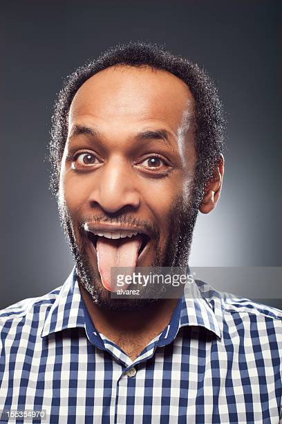 Portrait of a man with tongue out