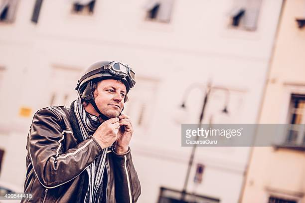 Portrait of a Man with Vintage Motorcycle Goggles and Helmet
