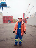 Portrait of a man working in a shipping yard