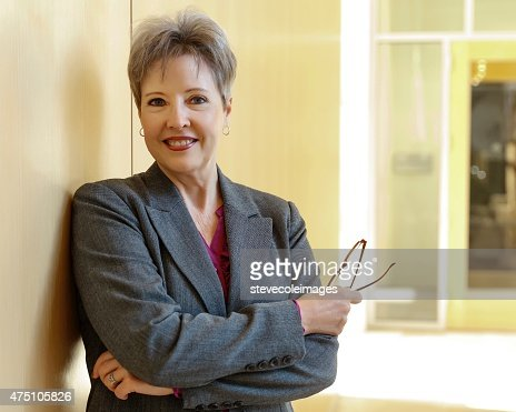 Portrait of a mature businesswoman in office interior.