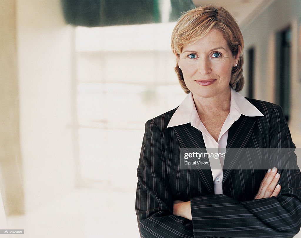 Portrait of a Mature CEO With Her Arms Crossed