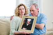 Couple holding a picture