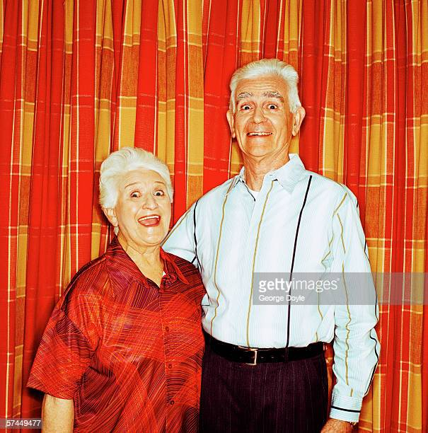 portrait of a mature couple standing together and smiling