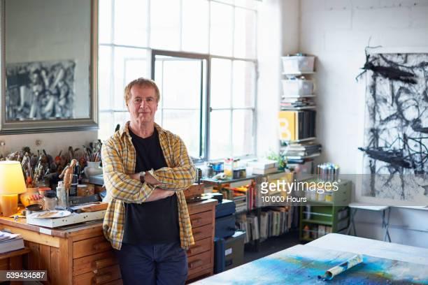 Portrait of a mature male artist in his studio