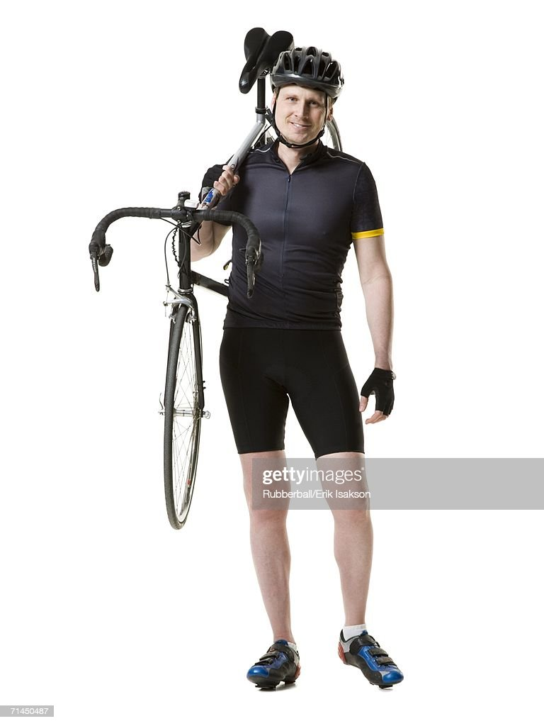 Portrait of a mature man carrying a cycle on his shoulder