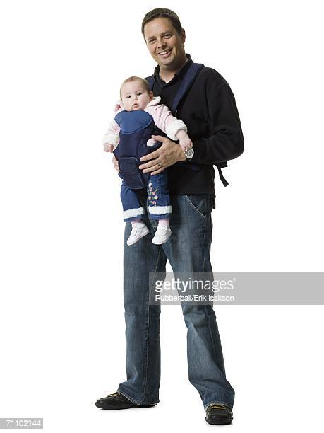 Portrait of a mature man carrying his daughter