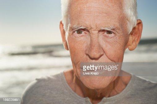 Portrait of a mature man on beach, close up : Stock Photo