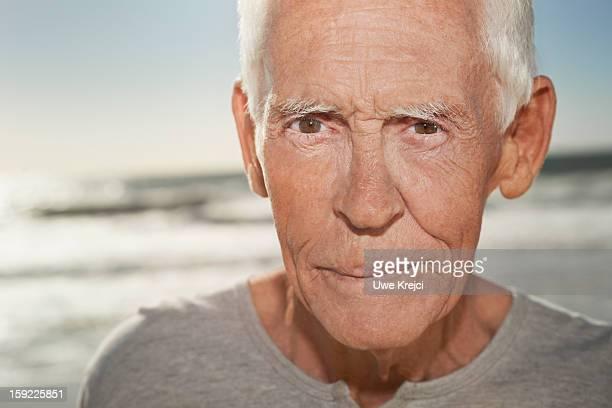Portrait of a mature man on beach, close up