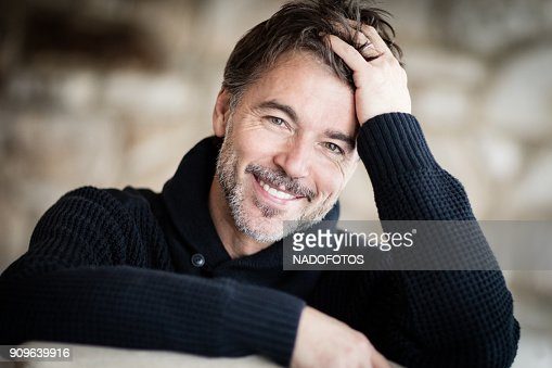 Portrait Of A Mature Man Smiling At The Camera. Home : Foto stock