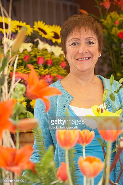 Portrait of a mature woman among assorted flowers
