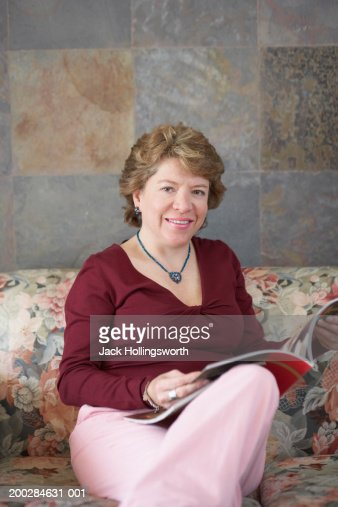 portrait of a mature woman reading a magazine on a couch stock photo getty images. Black Bedroom Furniture Sets. Home Design Ideas