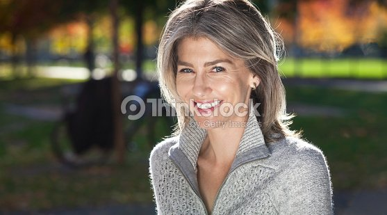 Portrait Of A Mature Woman Smiling At The Camera. Outside. : Foto de stock