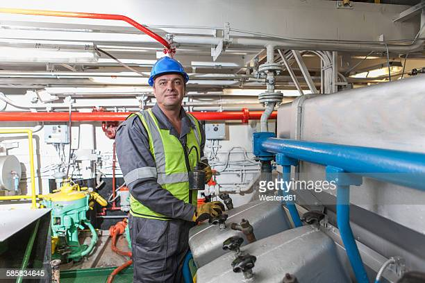 Portrait of a mechanic in engine room on a ship