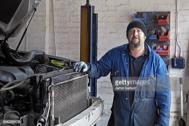 Portrait of a mechanic shoot in his garage