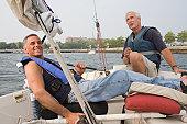 Two disabled men enjoying adaptive sailing