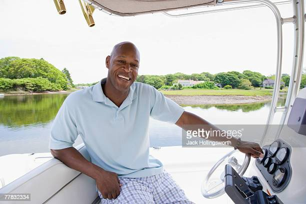 Portrait of a mid adult man sitting in a boat and smiling