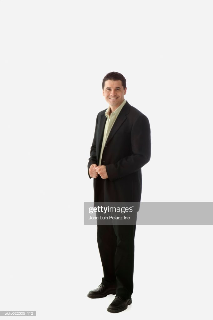 Portrait of a mid adult man smiling : Stock Photo