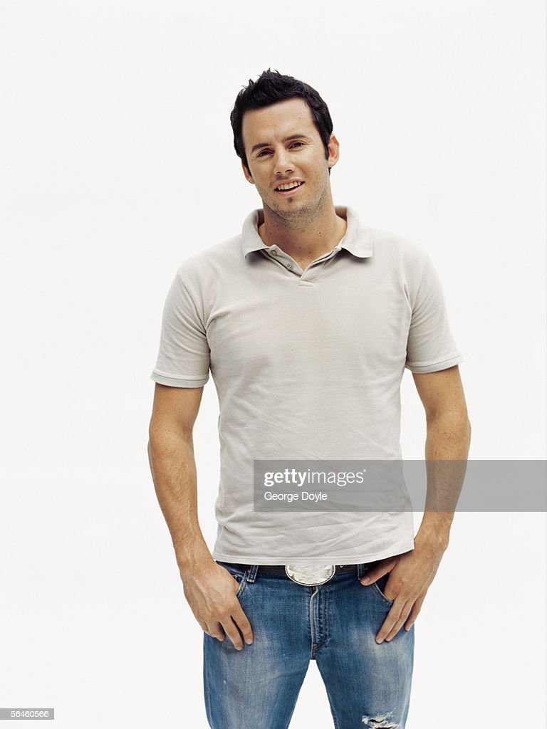 portrait of a mid adult man standing with his hands in his pocket