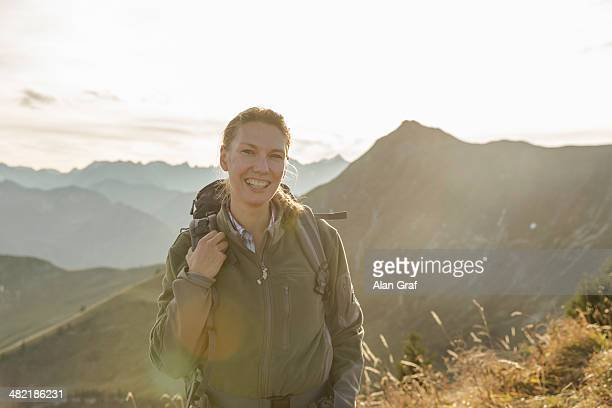 Portrait of a mid adult woman backpacker, Achensee, Tyrol, Austria