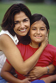 Portrait of a mid adult woman hugging her daughter