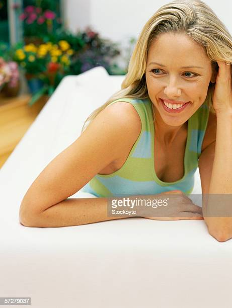 Portrait of a mid adult woman relaxing on a sofa
