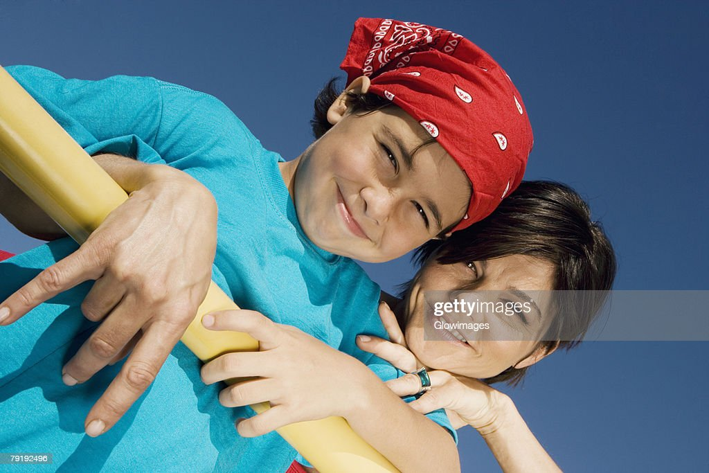 Portrait of a mid adult woman smiling with his son : Foto de stock