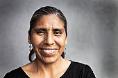 Portrait of a middle aged mexican woman smiling.