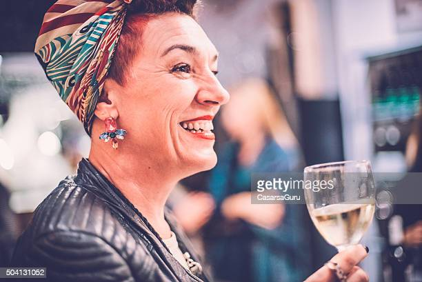 Portrait of a Middle Aged Woman Holding Glass of Wine