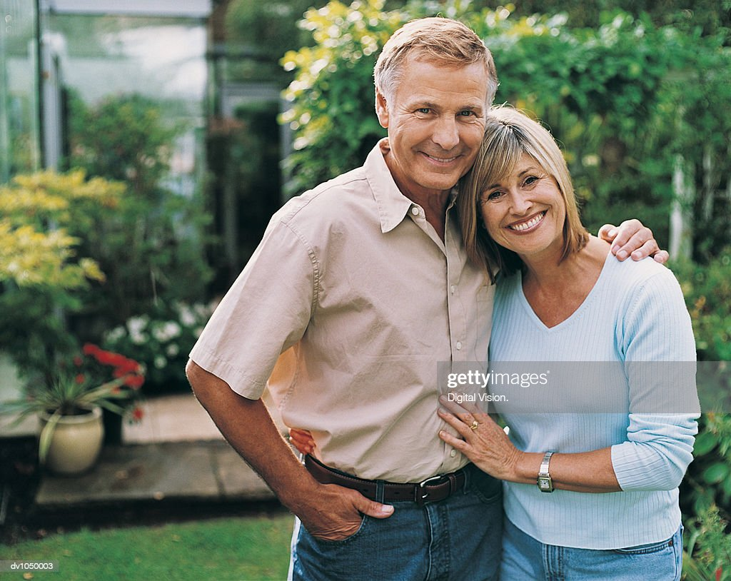 Portrait of a Middle-Aged Couple in Their Garden