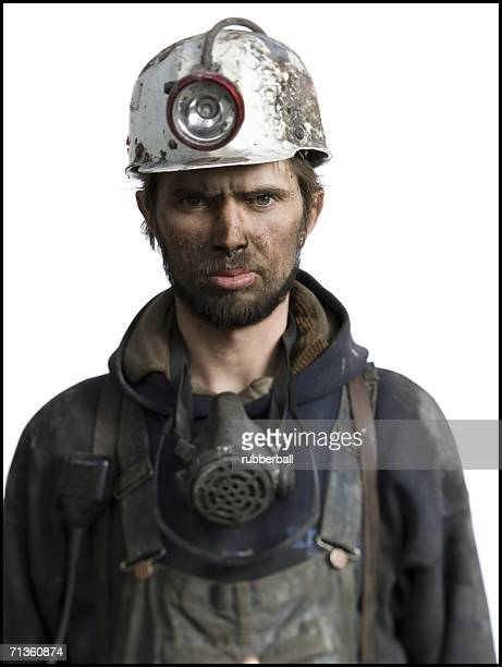 Portrait of a miner wearing a hardhat with a headlamp