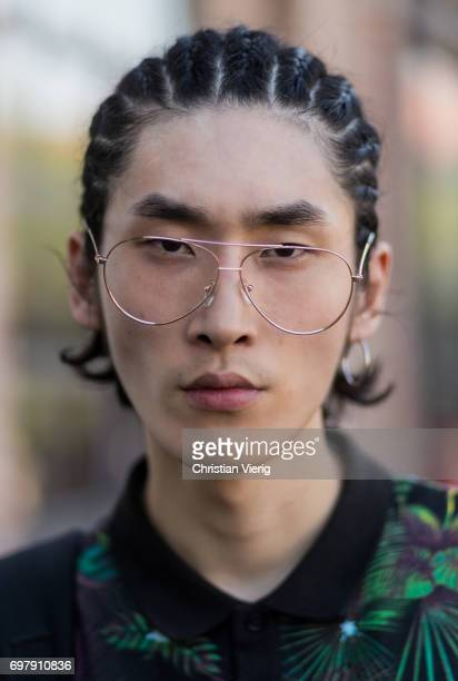 Portrait of a model wearing glasses is seen outside Malibu 1992 during Milan Men's Fashion Week Spring/Summer 2018 on June 19 2017 in Milan Italy