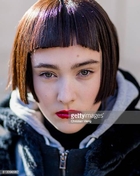 Portrait of a model with bob hair cut and red lipgloss outside Maison Margiela during the Paris Fashion Week Womenswear Fall/Winter 2016/2017 on...