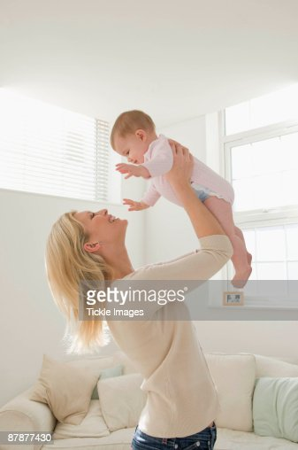 A portrait of a mother and baby : Stock Photo