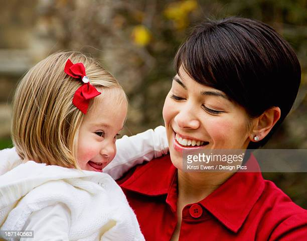 Portrait Of A Mother And Her Daughter With Down Syndrome