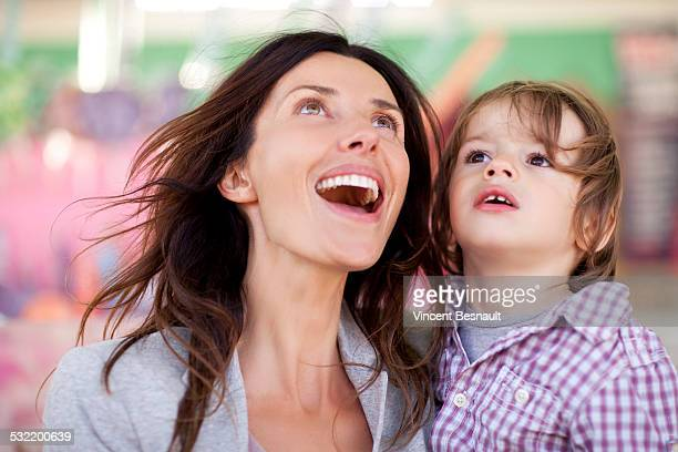 Portrait of a mother and her son at the carnival